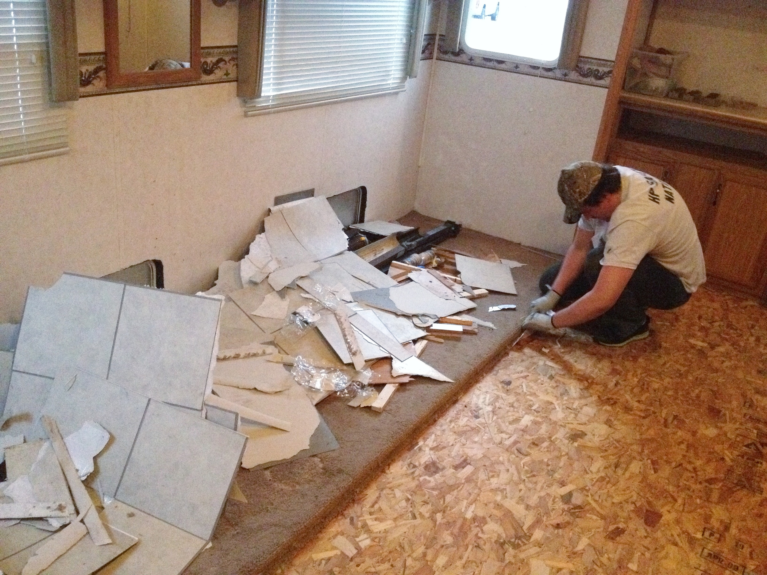 my husband, hard at work, ripping up the previous flooring.