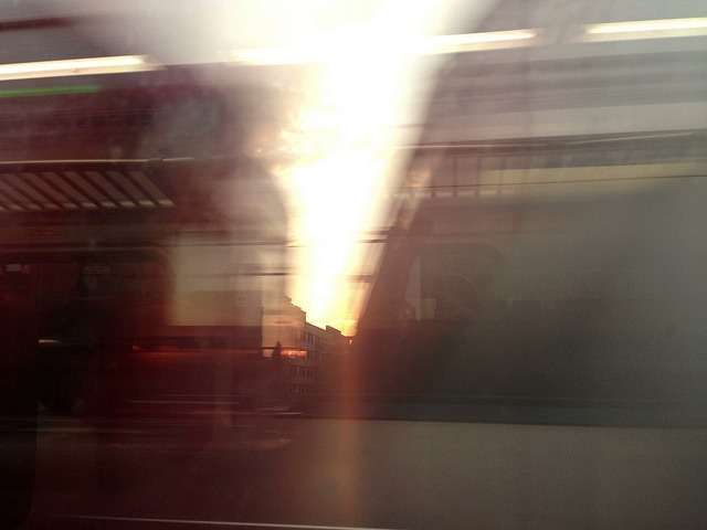 Sun rips through a passing train in Harlem. on Flickr.