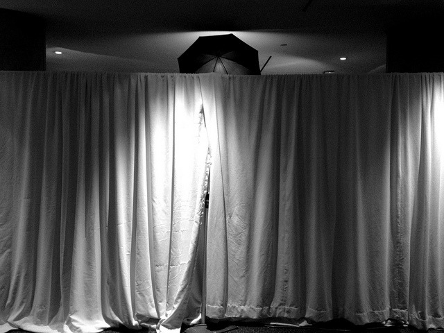 Santa, behind the curtain on Flickr.