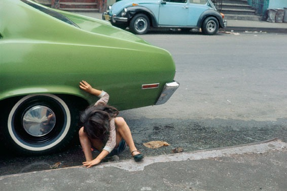 Girl crouching next to green car, New York' (1980) Since I'm inarticulate, I express myself with images. - Helen Levitt