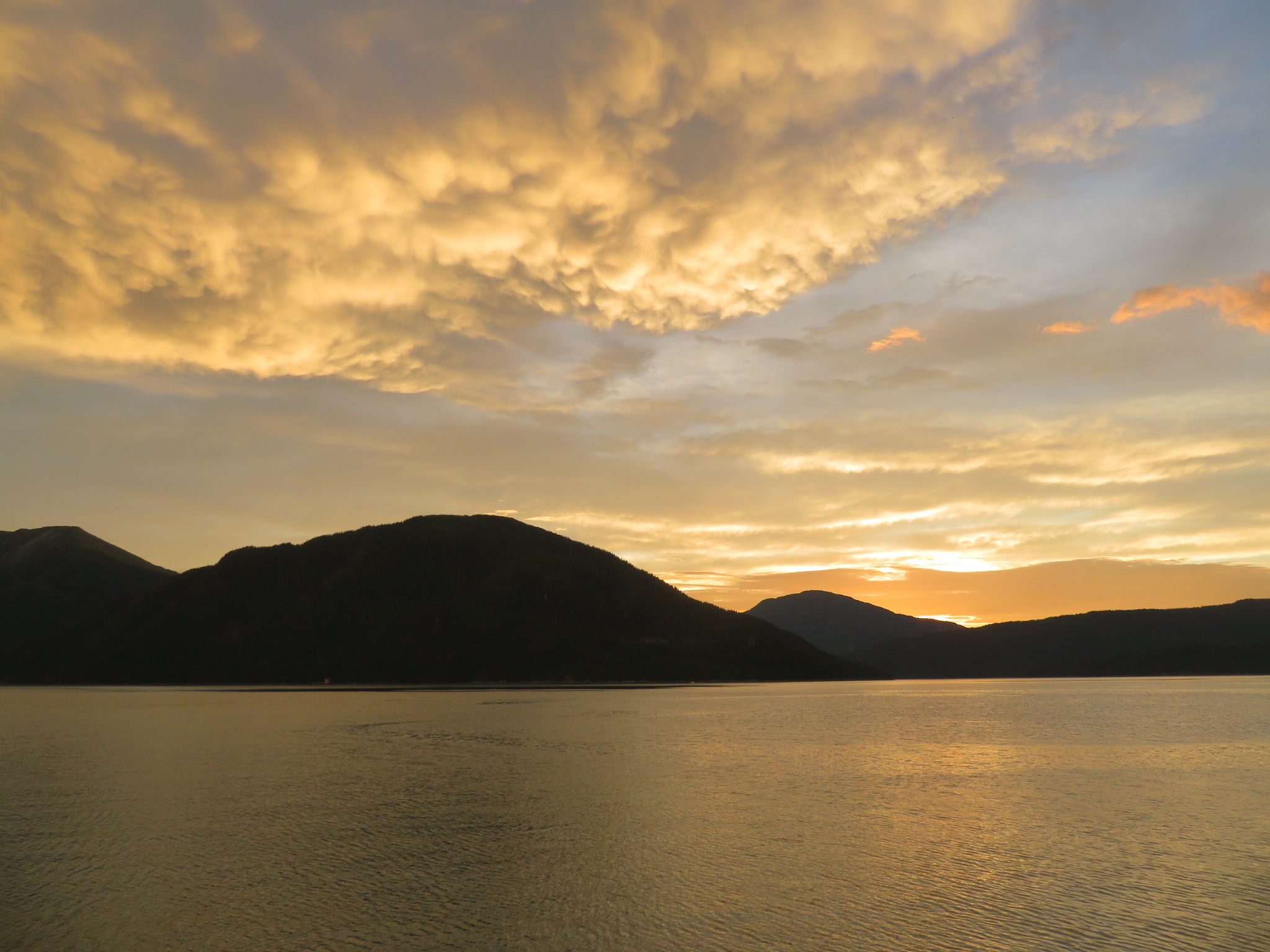golden sunset across the channel above Loretta island