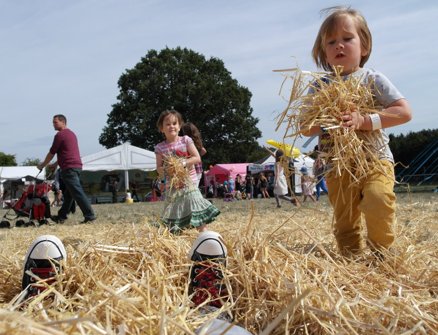 Playing in straw at The Big Feastival 2013