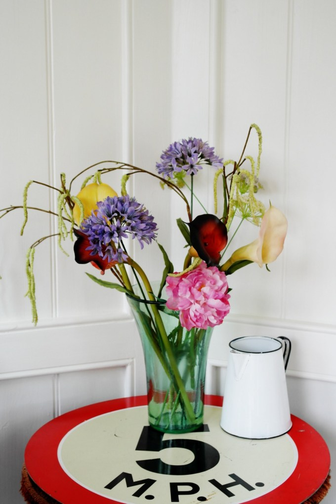 Inside the Summerhouse, the 5 mph table top still holds it own - even against the beautiful - and fake - flowers