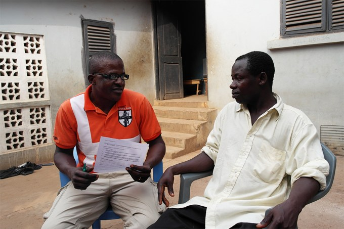 Bernard translates for Atta, who openly discusses the support he has had through the Basic Needs Trust