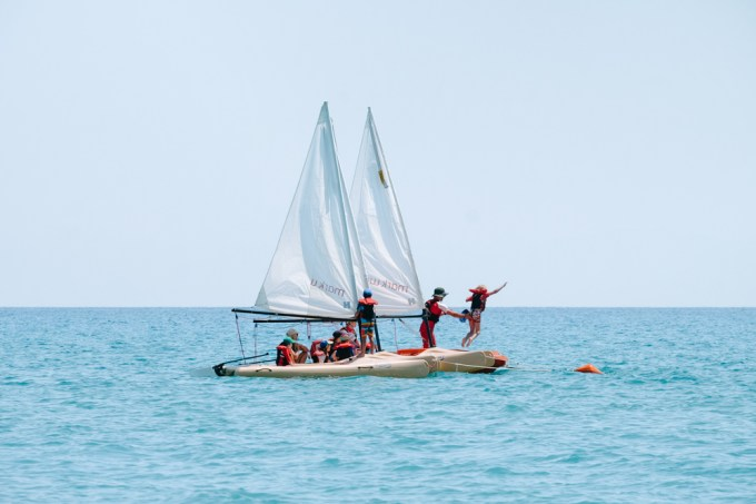 Jumping from the boat into the sea withkids Club sailing at Mark Warner Levante Resort