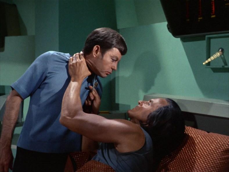 Dr. McCoy, having a conversation.