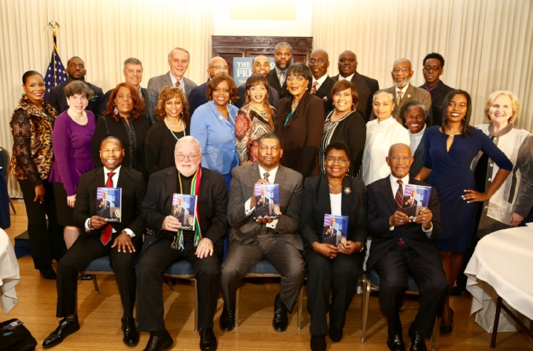 Henry P Davis, (left end seat from row), with fellow book contributors, including my brother, Harold A Carter (back row, 3rd from right). Darryl D. Sims, publisher (center front row)