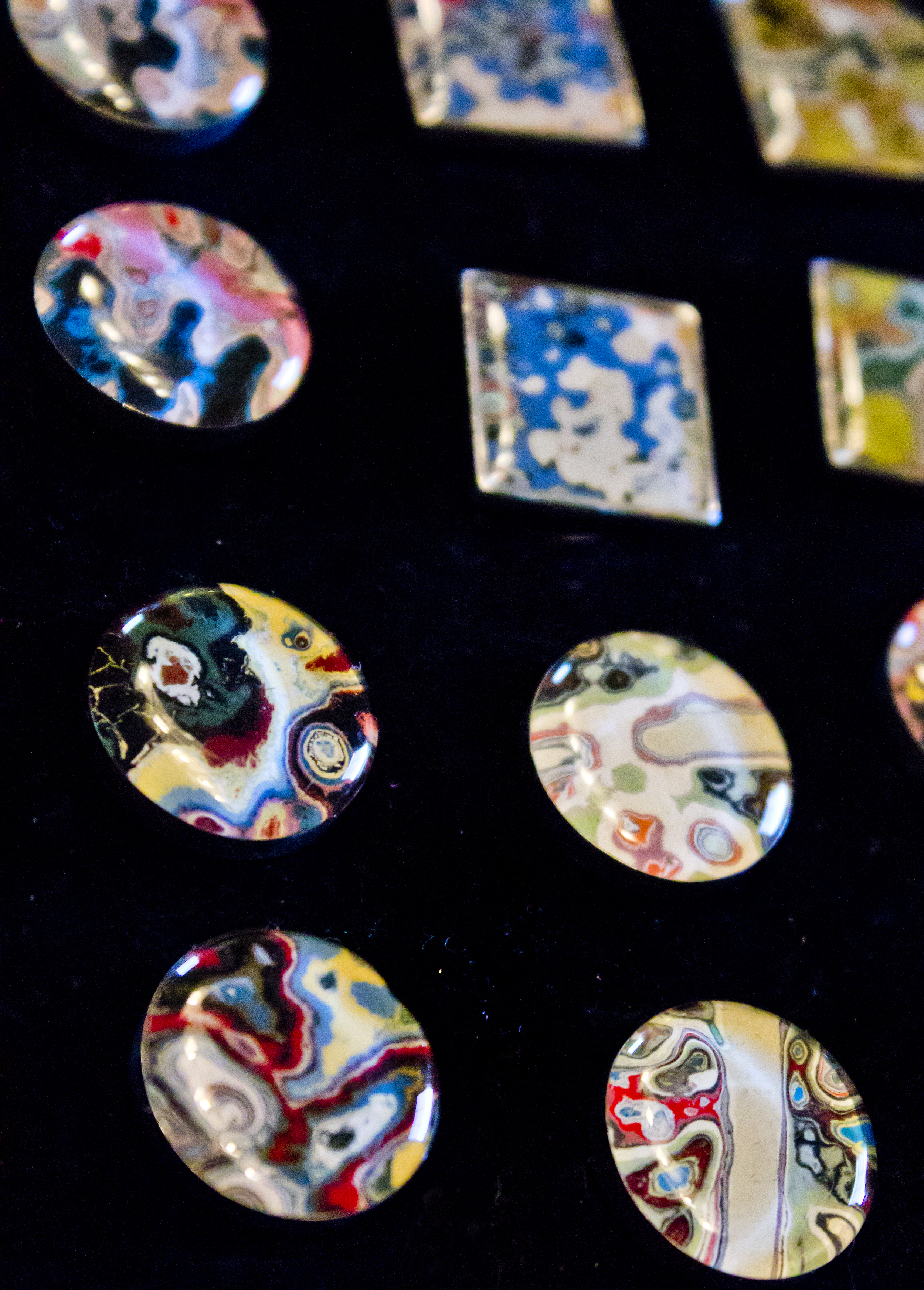 Cuff-links made out of shards of re-purposed graffiti. Photo by Amy Cooper
