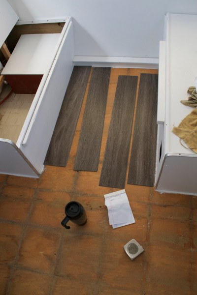 Reasons to Install Vinyl Plank Flooring in your Trailer or RV     Required tools  measuring tape  flooring  coffee  scratch pad
