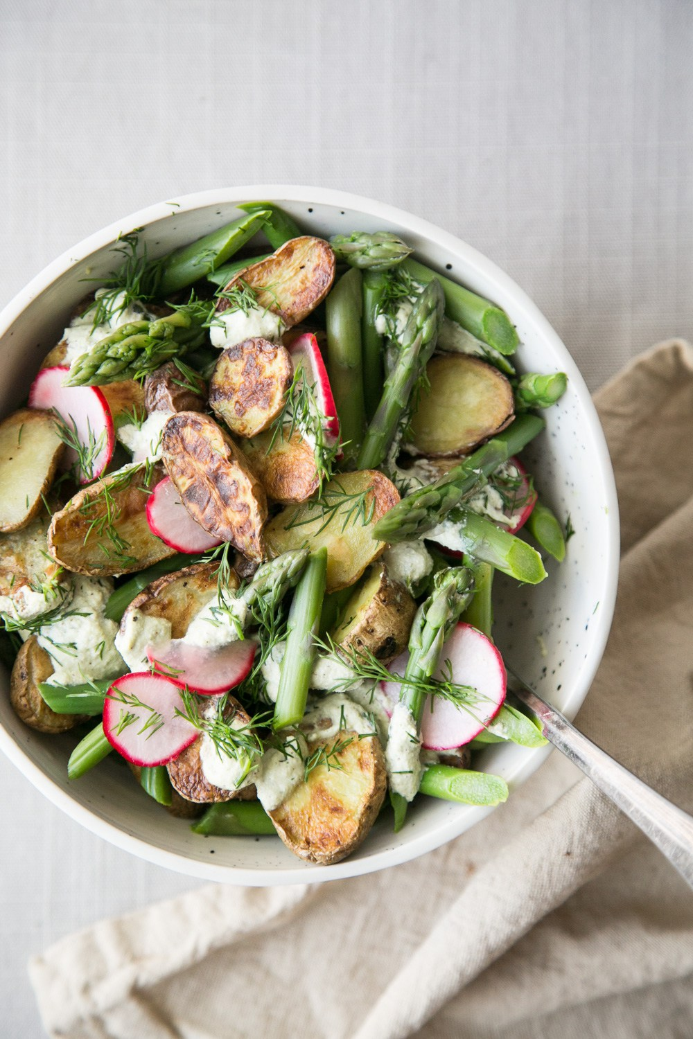 Potato Asparagus Salad with Pickled Radishes and Creamy Dill Sauce via The Green Life