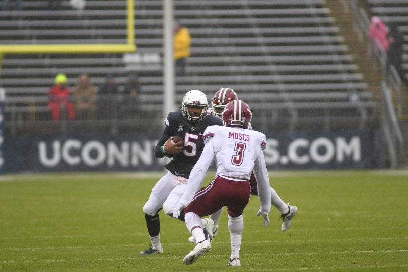 Quarterback David Pindell scrambles against UMass on Oct. 27, 2018 . (Charlotte Lao/ The Daily Campus)