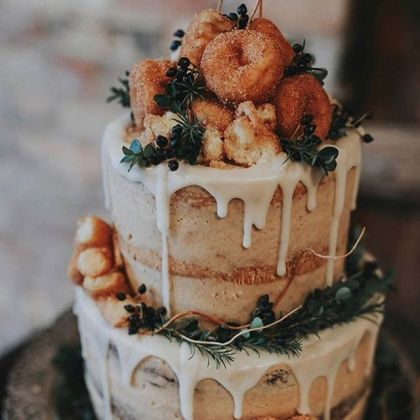 20 Beautiful Buttercream Wedding Cake Ideas     the bohemian wedding This incredible donut wedding cake is both festive and delicious  We ve  chosen our