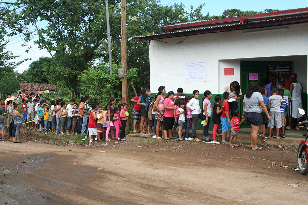 Kids line up outside the new learning center constructed and operated by La Esperanza Granada