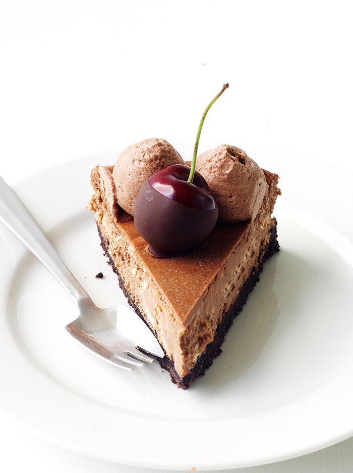 Baled Black Forest Chocolate Cheesecake with an Oreo crust and chocolate-dipped cherries | Sweetest Menu