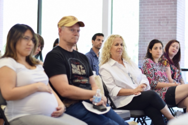 Photo: Participants at Embrace Your Pregnancy listening to the expert panel. Photo Credit: Cat Rencken Photography