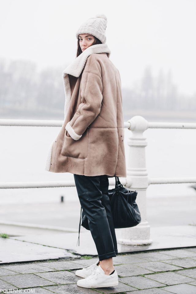 You might as well be wrapped in a blanket with the shearling coat. It is undeniably cozy and looks 70's chic with sock booties. Forever 21 has some great affordable options.