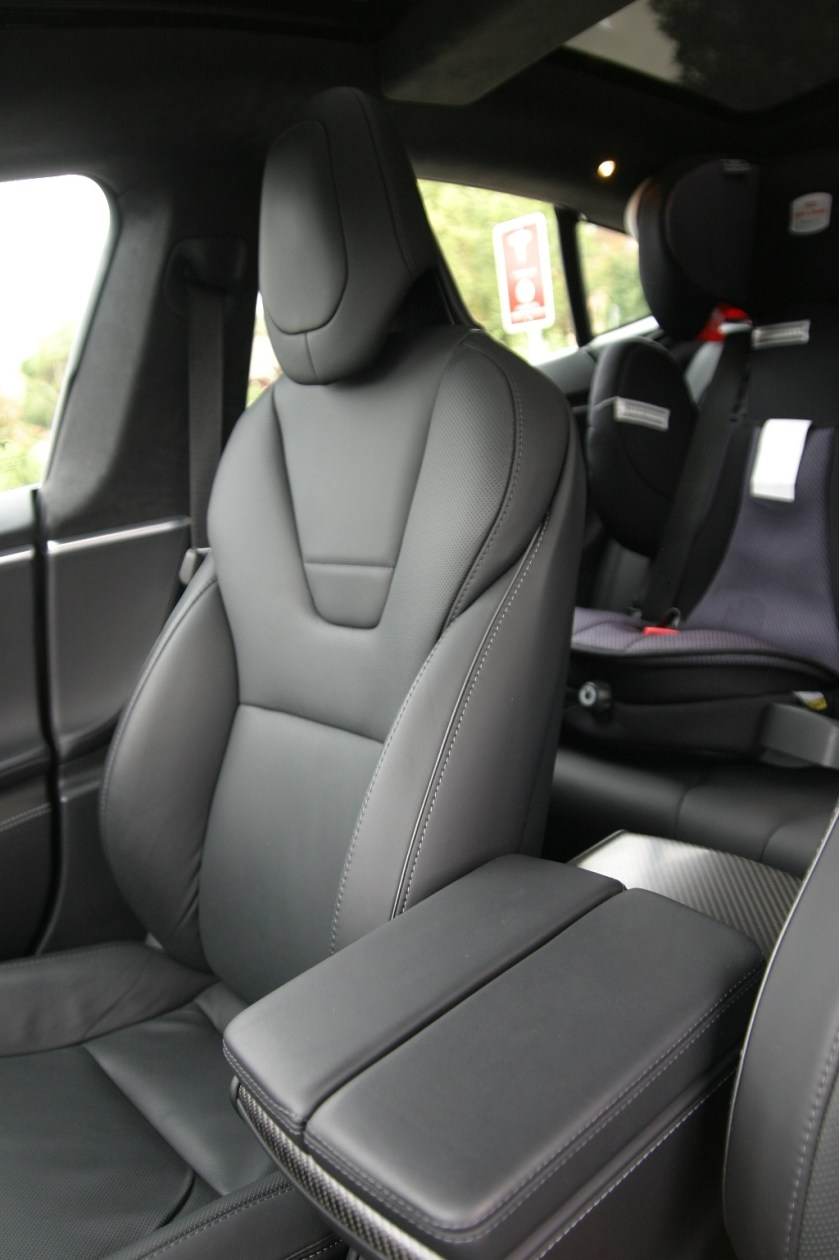 Front seat design reflects Tesla logo