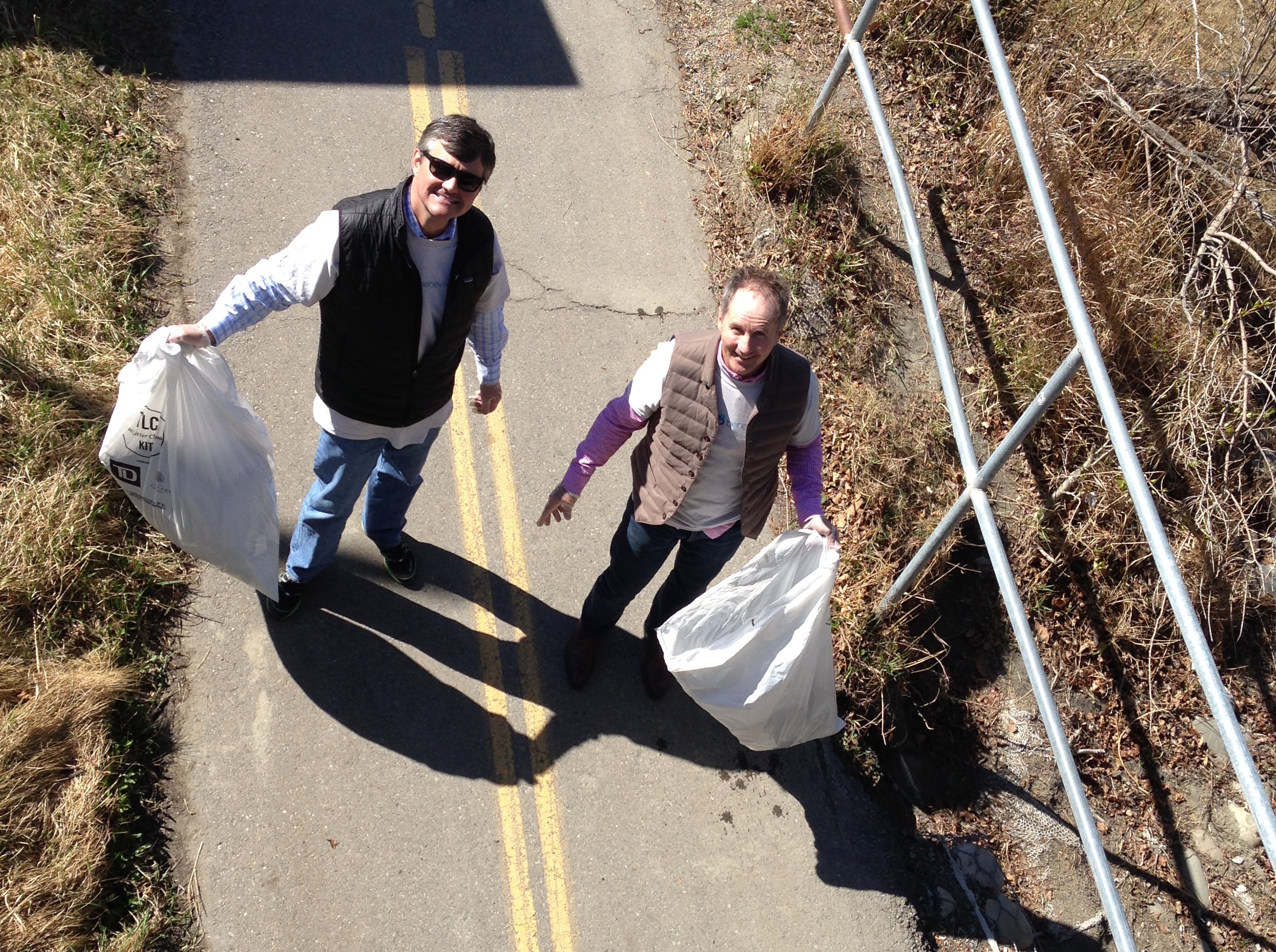 Bryan de Lottinville, Founder & CEO of Benevity, and Andy Howell, COO of Benevity, picking up garbage in Calgary, AB