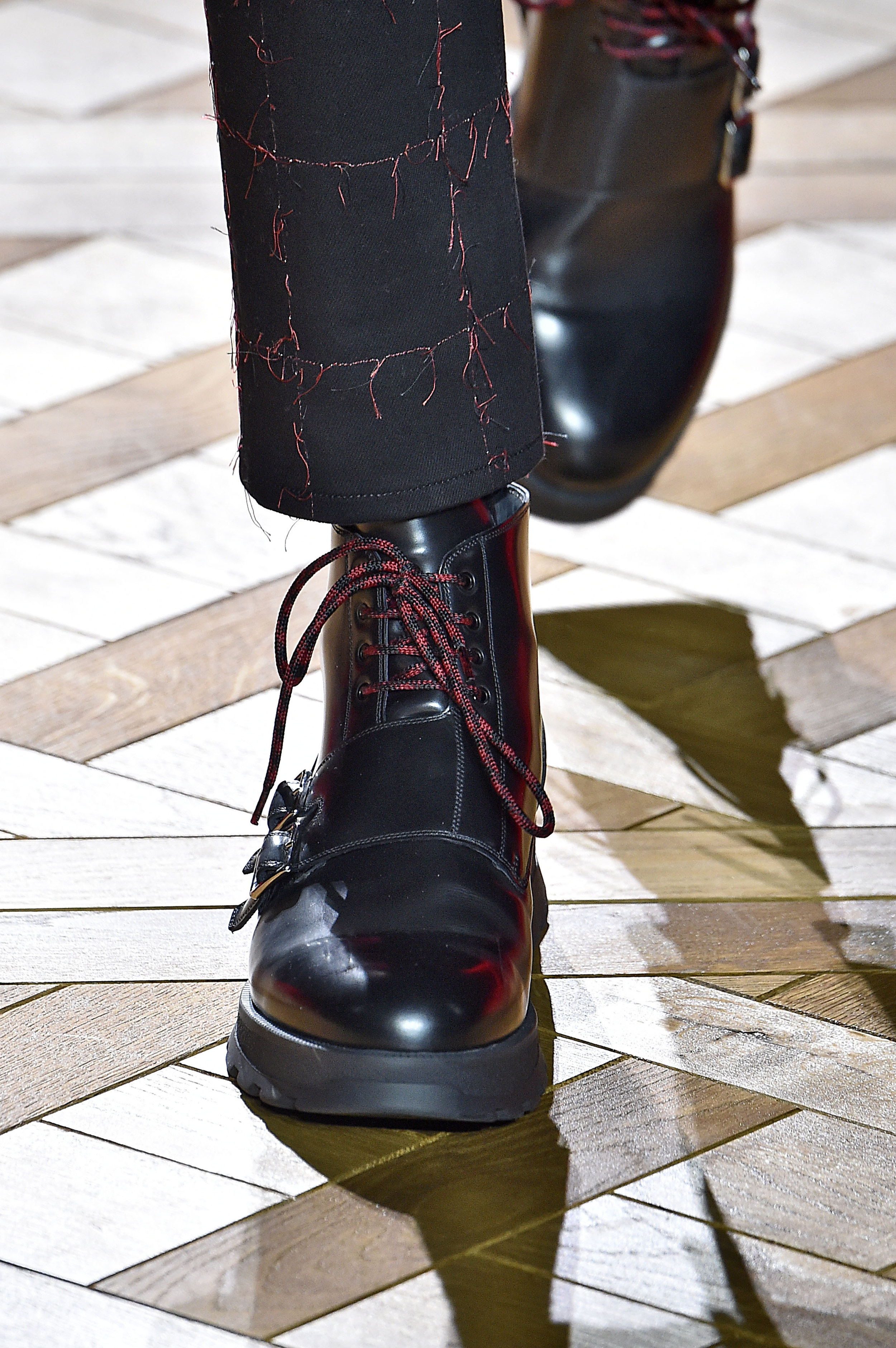 Heavy, leather military boots against the geometric, light hardwood floors bring textures and styles together to a whole new level.Photo: Architectural Digest