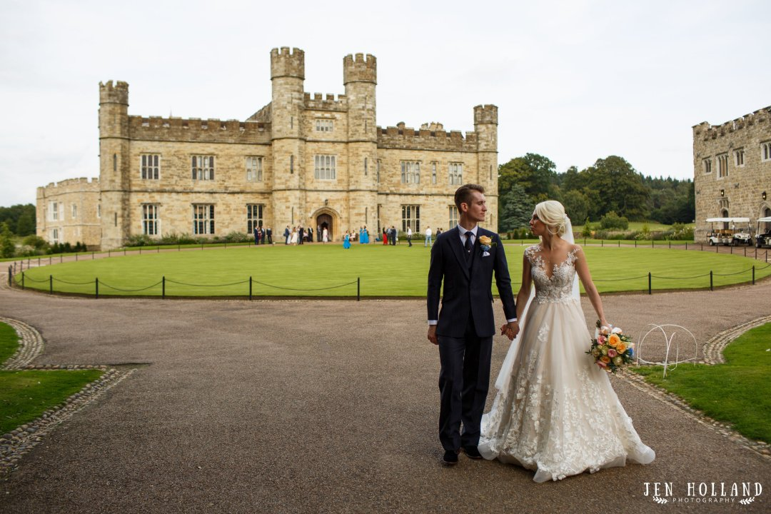 Bride and groom outside leeds castle kent