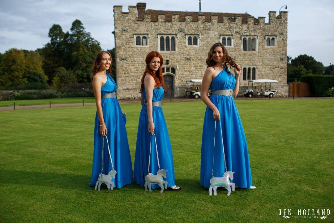 Bridesmaids with unicorn bags at leeds castle kent