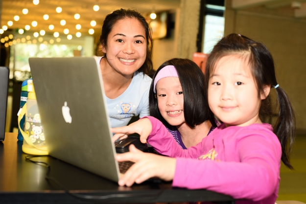 Emily de la Pena with a couple of coding kids