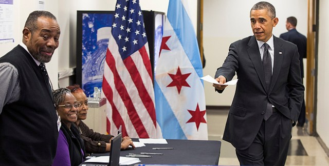 EVEN HE VOTED EARLY: President Barack Obama arrives to cast a ballot at the Dr. Martin Luther King Community Service Center in Chicago, Monday while participating in early voting.