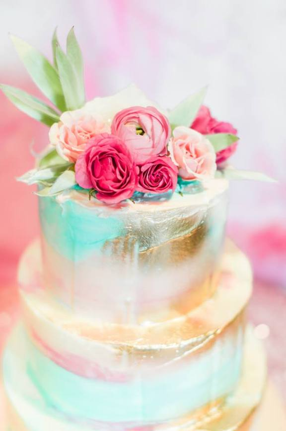 water color gold cake with flower topping