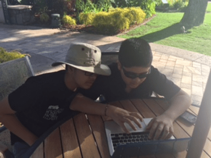 Niam and his brother are Rohan are enjoying a sunny afternoon hanging out together on the computer: its an activity they can do together, Niam can learn from Rohan, socialize and have fun