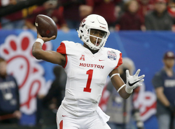 Houston Cougars quarterback Greg Ward Jr. (1) throws the ball in the first quarter against the Florida State Seminoles during the 2015 Chick-fil-A Peach Bowl at the Georgia Dome. Courtesy @UHCougarFB
