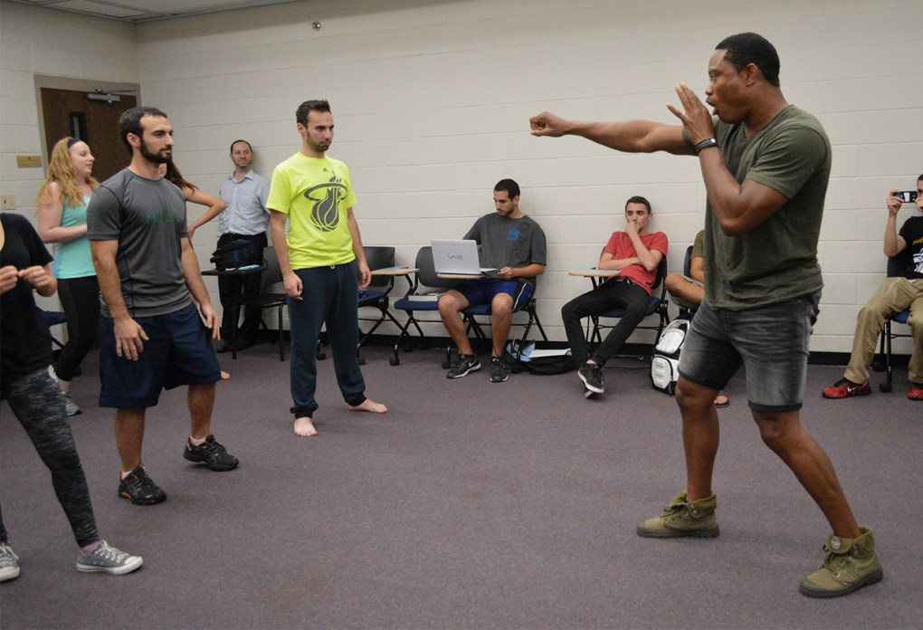 Instructor Pandit Mami, originally from Sierra Leone, demonstrates Israeli self-defense moves during a Knights for Israel meeting in UCF's Engineering I building on Wednesday, Sept. 14, 2016.