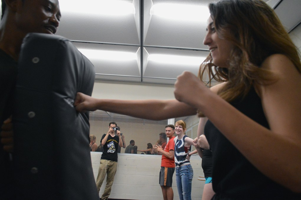 UCF sophomore Rachel Kammerman hits a punching mat during the Krav Maga self-defense lesson in UCF's Engineering I building on Wednesday, Sept. 14, 2016. Krav Maga, an Israeli form of self-defense, is used by the Israel Defense Forces and combines boxing, wrestling and other fight training.