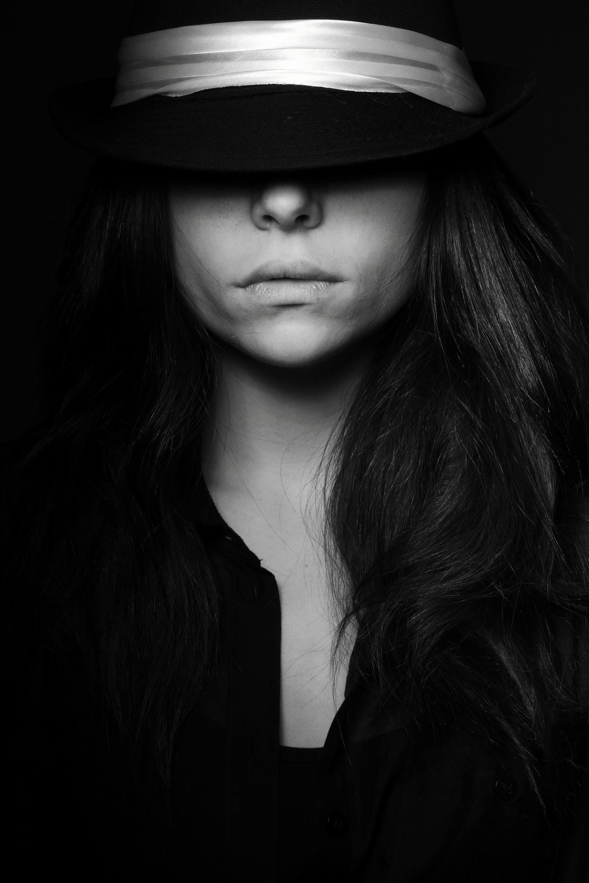 Experiment with lighting, there are no standard rules for lighting when it comes to black and white portraiture.