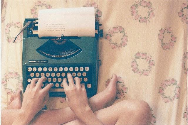 Woman Typing on Vintage Typewriter
