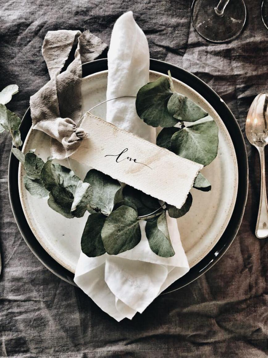 Mini eucalyptus wreaths make a nice table setting