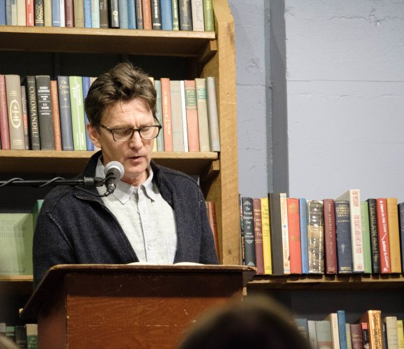 Andrew McCarthy reading JFA color