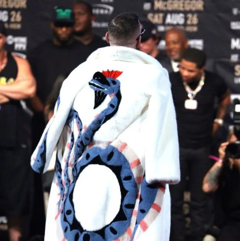 0a51211b5 He wore this custom Gucci mink coat during one of his press tours for UFC.  He has a flamboyant style he isn't afraid to show off. He likes to draw  attention ...
