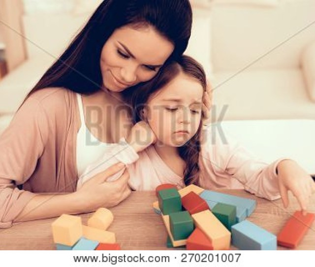 Mom Teaches Daughter Educational Games Learning Child At Home Build House Of Cubes