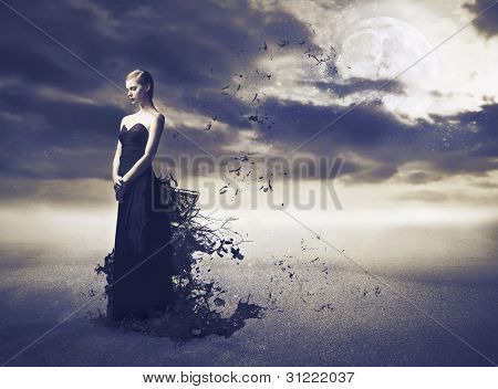 Beautiful woman wearing an evening gown melting away