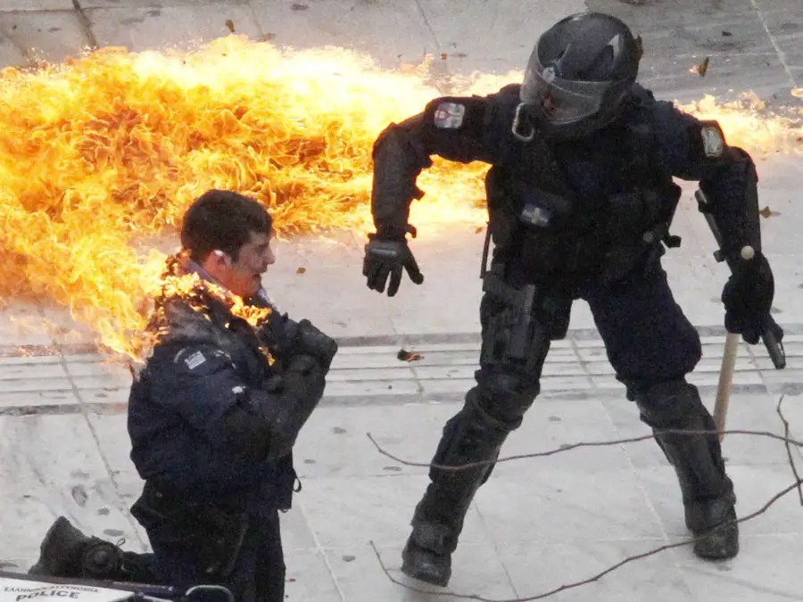 greece policeman burning