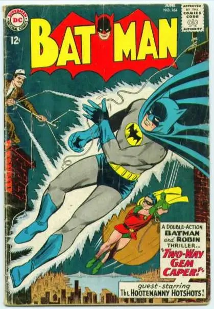 "1960s: ""Silver Age Batman"": The comics added the gold oval to his 1940s Golden Age counterpart."