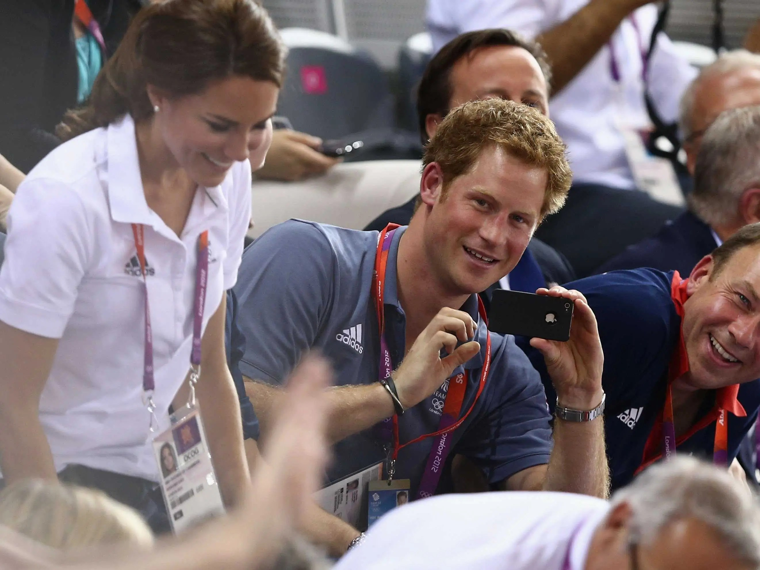 Aug. 2, 2012: Prince Harry uses his iPhone 4S while watching a track cycling event during the London Summer Olympics.