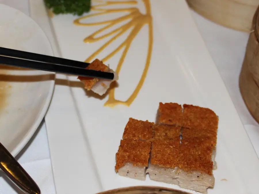 This roast pork, from Crystal Jade Palace Restaurant, is crunchy and crispy on top and fatty and delicious on the bottom.