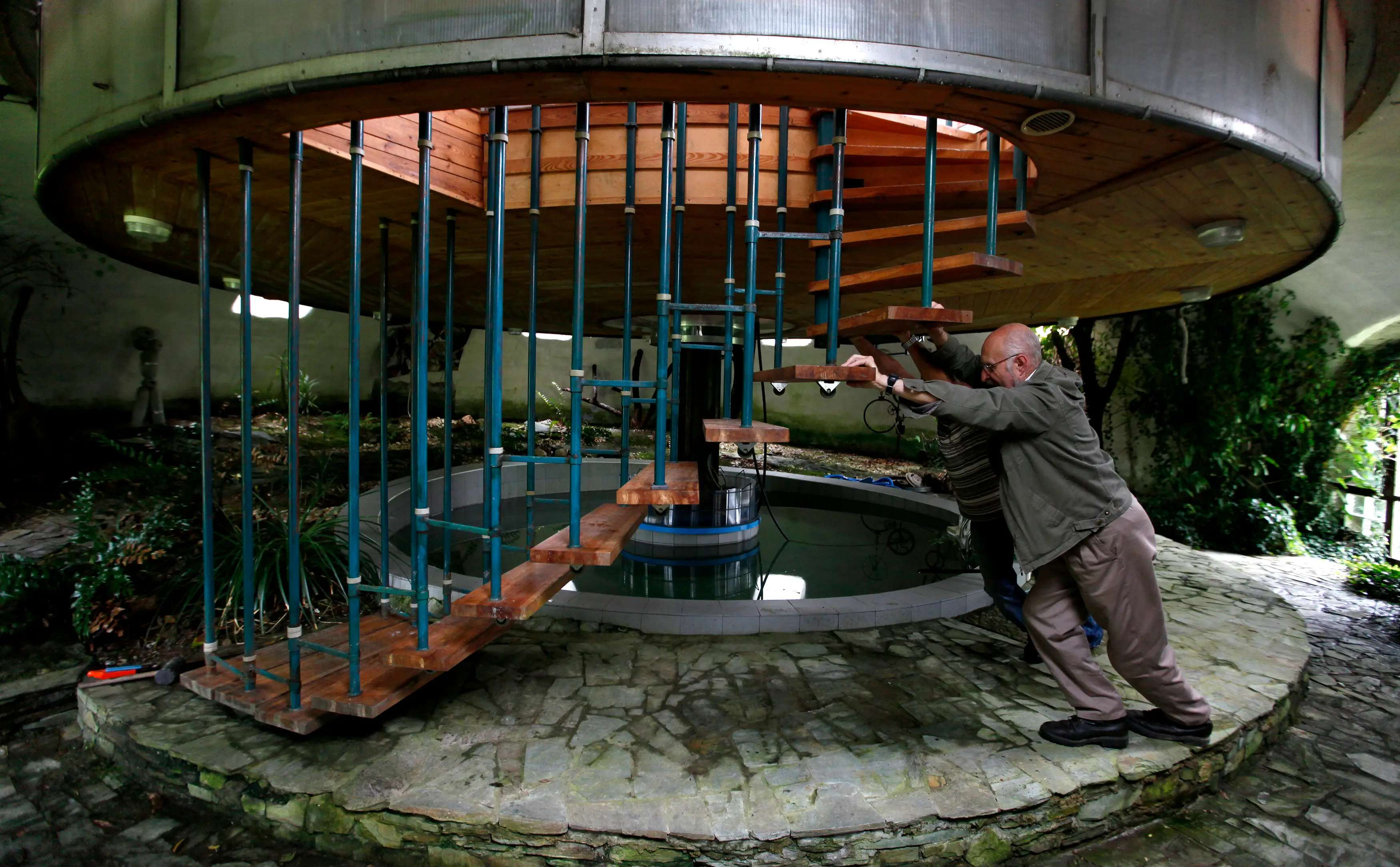 73-year-old builder Bohumil Lhota created a turning house in a small village north of Prague, Czech Republic. He started building it in 1981, and finished in 2002. His home rotates so he can have the best view at all times, and can also move up and down.