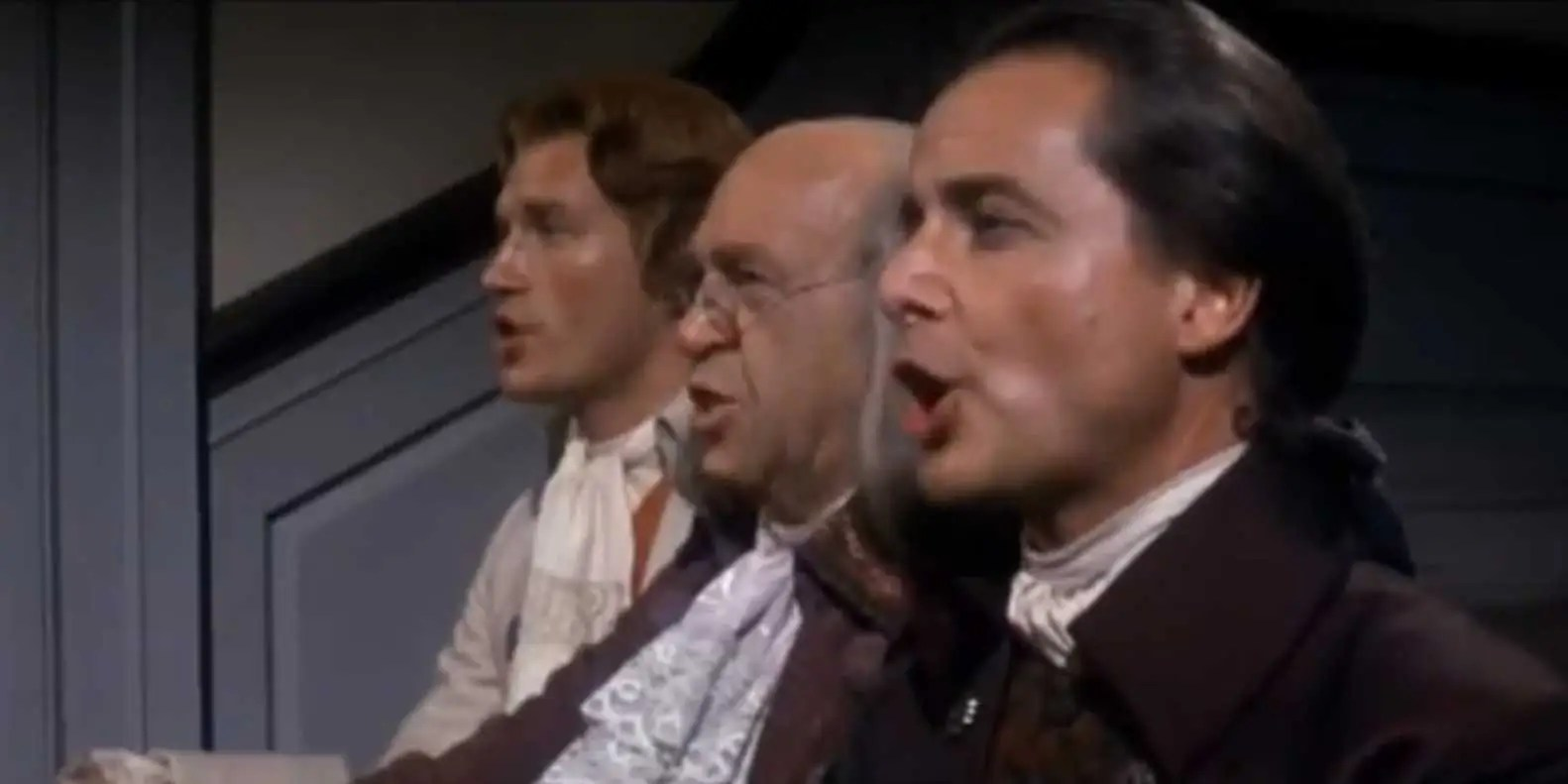 """1776"" (1972): Benjamin Franklin and John Adams (William Daniels) peer-pressure Thomas Jefferson to write the Declaration of Independence days before the 4th — in song and dance!"