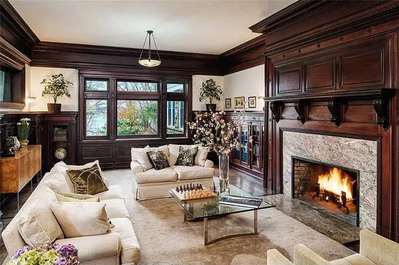 All the rooms have 12-foot ceilings, including the paneled library with its cozy fireplace.