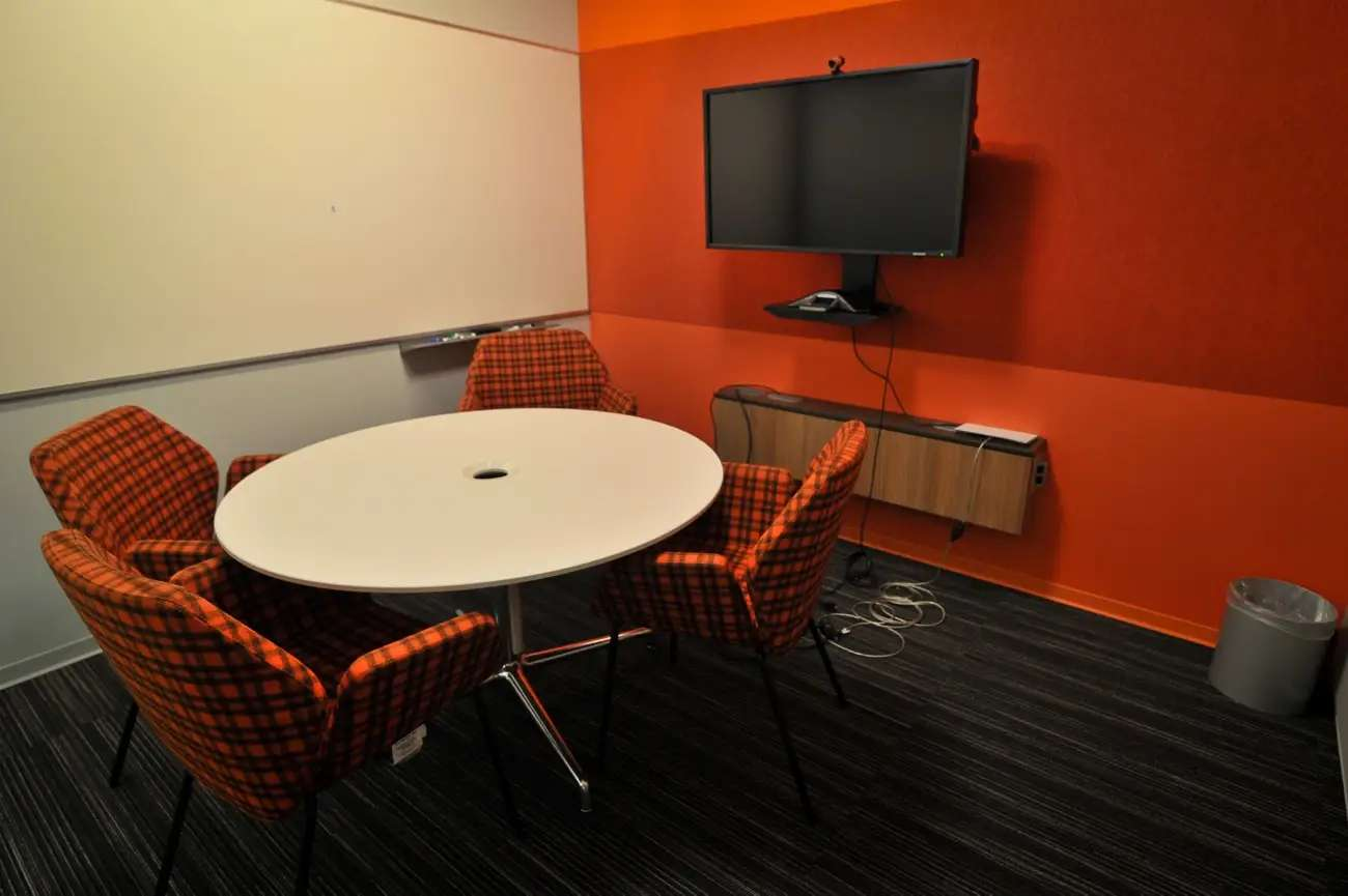 But, Microsoft is going for the new look, as you can see in this bright red conference room.