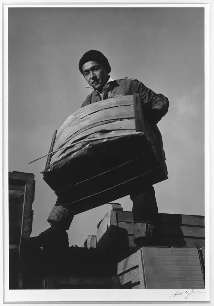 Here, Tsutomu Fuhunago lifts a produce crate.