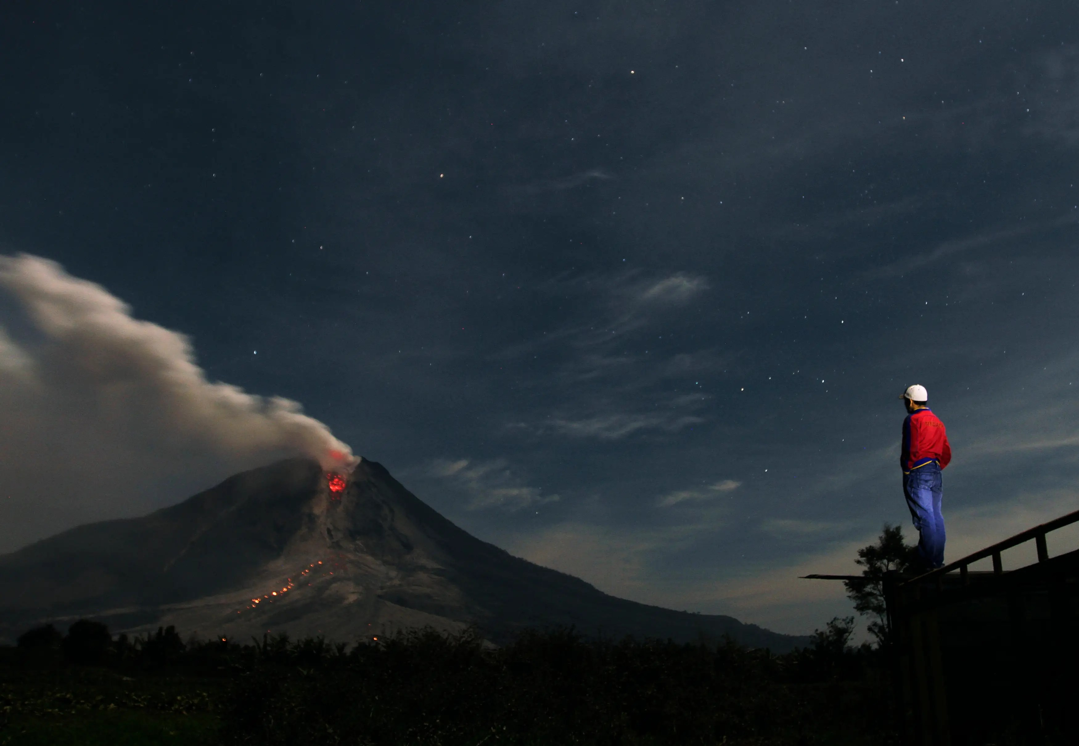 Mount Sinabung, a large volcano on Sumatra Island in Indonesia, has been erupting on and off since September of 2013, covering the area with ash and forcing thousands of people to flee their homes.
