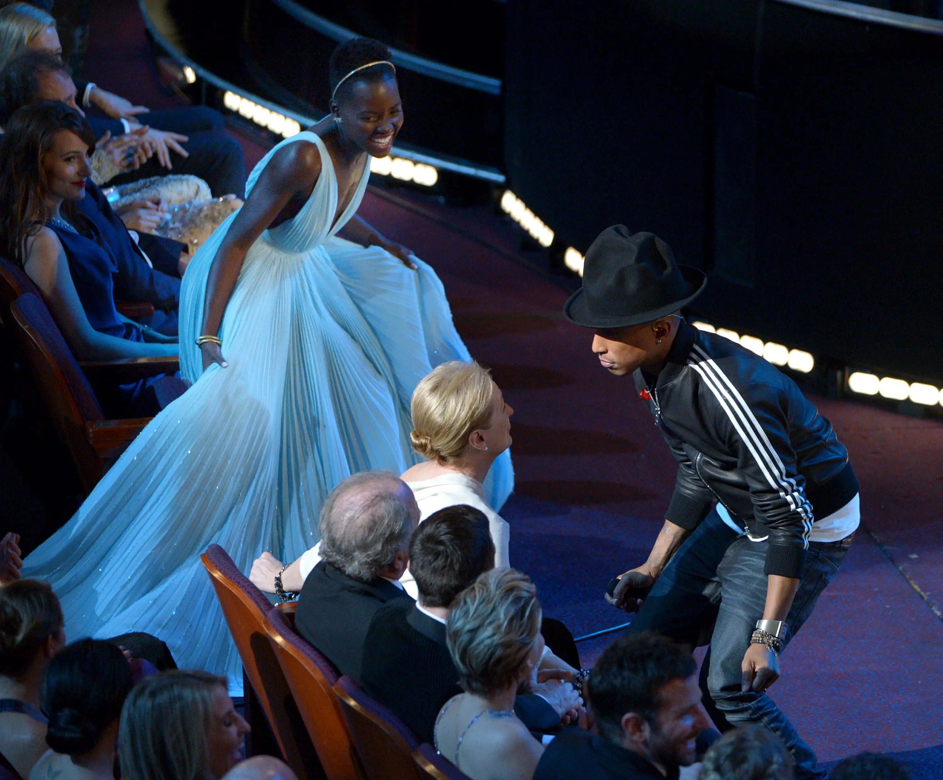 "Pharrell danced to his Oscar-nominated song ""Happy"" along with Academy Award nominees Nyong'o and Streep."